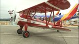 VIDEO: Veterans fly on free flights aboard WW II biplanes