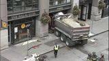 VIDEO: Truck careens into Pioneer Square sandwich shop after mechanical failure
