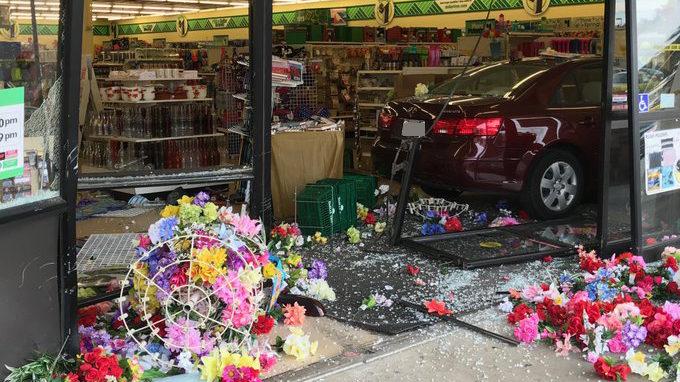 Car slams into dollar store in Monroe