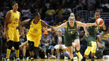 Sami Whitcomb #33 of the Seattle Storm takes the ball down the court as Alexis Jones #1 of the Los Angeles Sparks follows during a game at Staples Center on August 04, 2019 in Los Angeles, California. (Photo by Katharine Lotze/Getty Images)
