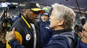 Head coach Pete Carroll (R) of the Seattle Seahawks is congratulated by head coach Mike Tomlin of the Pittsburgh Steelers after the Seahawks defeated the Steelers 39-30 at CenturyLink Field. (Photo by Otto Greule Jr/Getty Images)