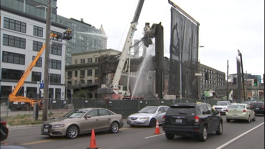 People stop, watch final piece of Viaduct along waterfront come down