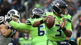SEATTLE, WASHINGTON - OCTOBER 03: Quarterback Russell Wilson of the Seahawks delivers a pass against the defense of the Los Angeles Rams in the game at CenturyLink Field on Oct. 03, 2019 in Seattle, Washington. (Photo by Abbie Parr/Getty Images)