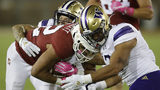 Stanford's Cameron Scarlett, center, is tackled by Washington's Elijah Molden, left, and Brandon Wellington during the first half of an NCAA college football game Saturday, Oct. 5, 2019, in Stanford, Calif. (AP Photo/Ben Margot)