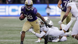 Washington's Salvon Ahmed (26) is tackled by Oregon's Nick Pickett in the first half of an NCAA college football game Saturday, Oct. 19, 2019, in Seattle. (AP Photo/Elaine Thompson)