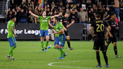 LOS ANGELES, CALIF. - OCTOBER 29: Gustav Svensson of Sounders celebrates a 3-1 win next to Walker Zimmerman of Los Angeles FC during the Western Conference finals at Banc of Calif. Stadium on Oct. 29, 2019, in L.A. (Photo by Harry How/Getty Images)