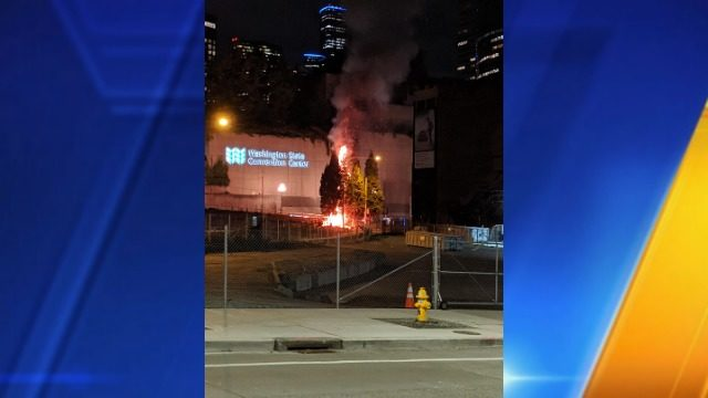Fire burns trees at Washington State Convention Center