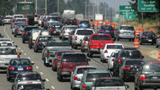 Traffic backs up northbound during Friday afternoon's rush-hour traffic on Interstate 5 through Joint Base Lewis-McChord July 29, 2011. (Tony Overman/News Tribune file photo)